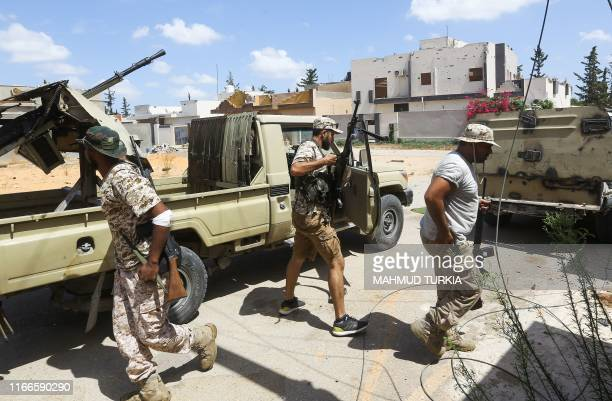 Fighters loyal to the internationally recognised Libyan Government of National Accord gather during clashes with forces loyal to strongman Khalifa...
