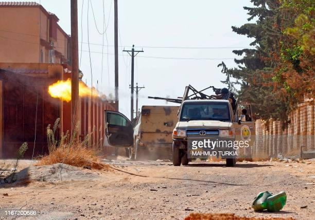 Fighters loyal to the internationally recognised Libyan Government of National Accord fires a truck-mounted gun during clashes with forces loyal to...
