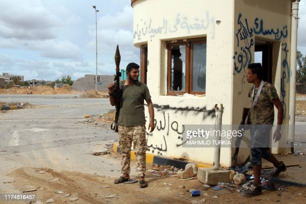 Fighters loyal to the internationally recognised Libyan Government of National Accord gather at the frontline where clashes have been raging with...