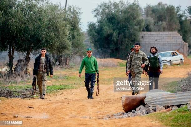 Fighters loyal to the internationally recognised Libyan Government of National Accord patrol an area south of the Libyan capital Tripoli on January...