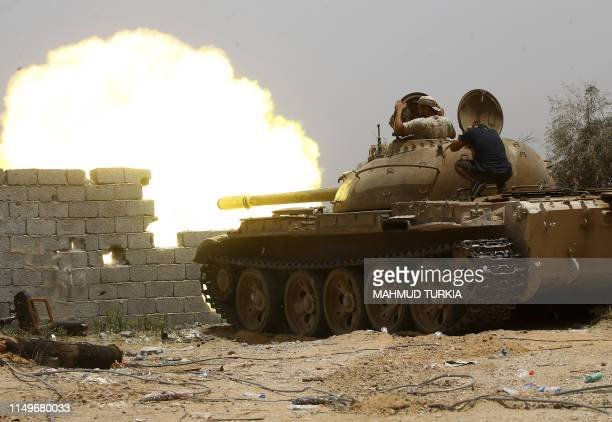 Fighters loyal to the internationally-recognised Government of National Accord open tank fire from their position in the al-Sawani area south of the...