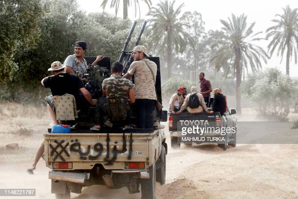 Fighters loyal to the Libyan internationallyrecognised Government of National Accord step up to the front during clashes against forces loyal to...