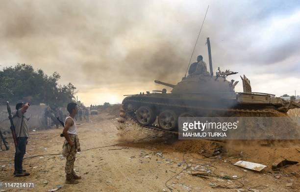 Fighters loyal to the Libyan internationallyrecognised Government of National Accord are pictured near the frontline during clashes against forces...