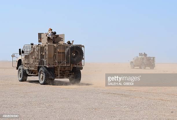 Fighters loyal to Yemeni President Abedrabbo Mansour Hadi drive towards the strategic Bab al-Mandab Strait, in the southern Yemeni province of Taez,...