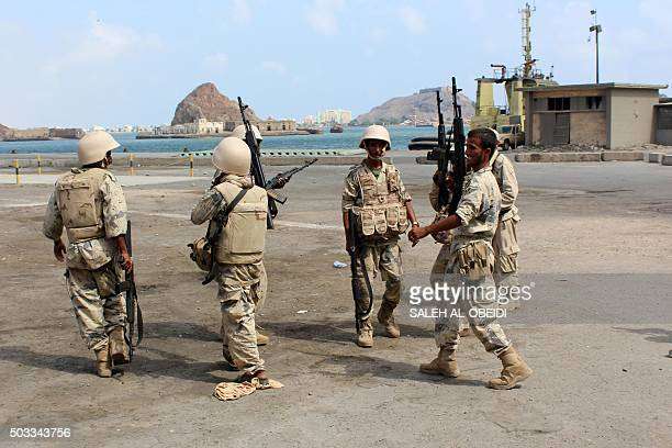 Fighters loyal to Yemen's President Abedrabbo Mansour Hadi celebrate after they managed to secure completely and take control of the port of the...