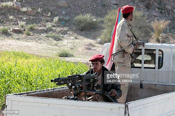 Fighters loyal to Yemen's President Abedrabbo Mansour Hadi ride in the back of a pick up car in the Shabwa province east of the Red Sea port of Aden...