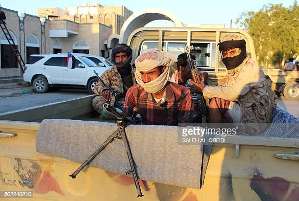 Fighters loyal to Yemen's President Abedrabbo Mansour Hadi ride in the back of a truck in the Shabwa province east of the Red Sea port of Aden on...