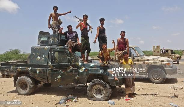 Fighters loyal to Yemen's separatist Southern Transitional Council stand guard in the Sheikh Salim area in the southern Abyan province on May 18...