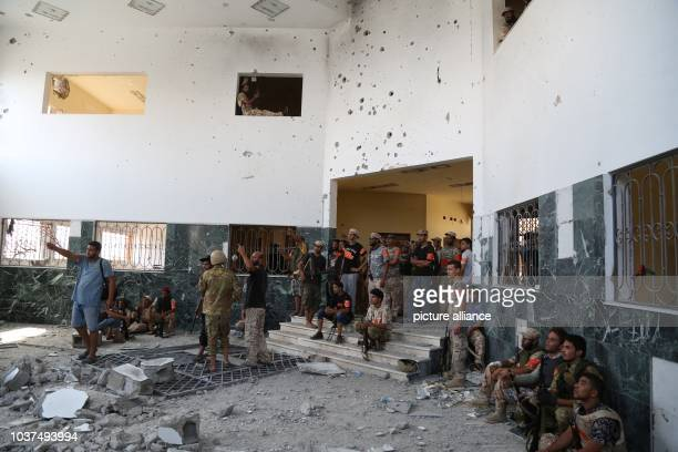 Fighters of Al Bunyan Al Marsus Libyan unity-Gov forces at the State Property Service building, asking their colleague to move back from this place...