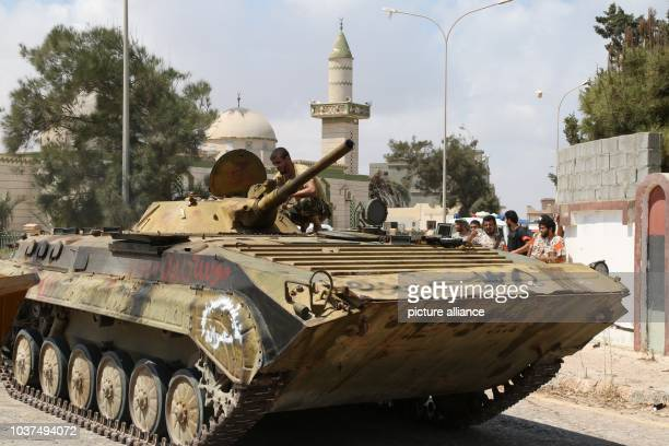 Fighters of Al Bunyan Al Marsus Libyan unity-Gov forces with a tank in front of Alquds mosque after controlling the area, in Sirte, Libya, 3...