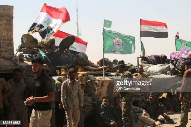Fighters of Hashed AlShaabi gather around the Tal Afar airport west of Mosul as they and Iraqi forces backed by local militia and a USled coalition...