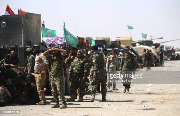 Fighters of Hashed AlShaabi gather at the Tal Afar airport west of Mosul as Iraqi forces backed by local militia and a USled coalition advanced in...