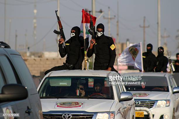 Fighters of the Ansar Allah al-Awfiya Shiite group parade with their weapons on June 16, 2015 in the southern Iraqi city of Basra during celebrations...