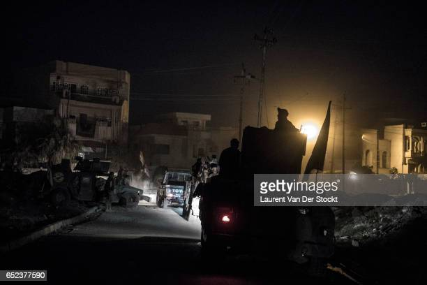 Fighters of the emergency response division leave for nighttime operations in west Mosul.