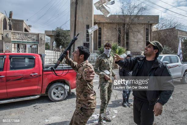 Fighters of the federal police are celebrating their victory in a district taken back from the Islamic State in western Mosul.
