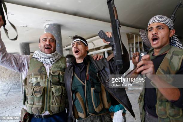 Fighters of the Free Syrian Army are celebrating their victory on a governmental hospital that they captured form the Assad regime There is a huge...