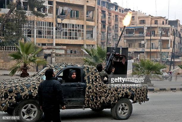 Fighters of the Free Syrian Army fire an antiaircraft weapon in Aleppo's rebelheld area of Mashhad on December 12 as they battle Syrian government...