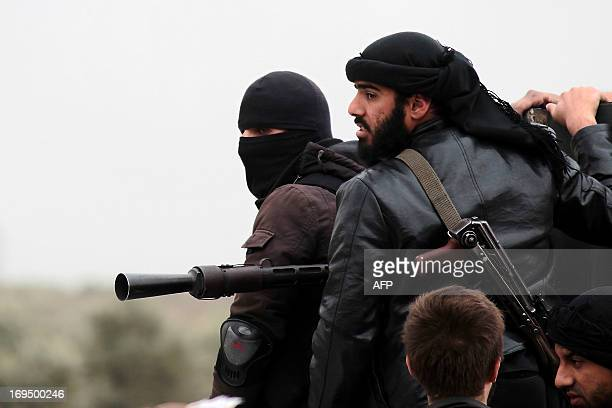 Fighters of the jihadist group AlNusra Front stand on the top of a pickup mounted with a machine gun during fightings against the regime forces on...