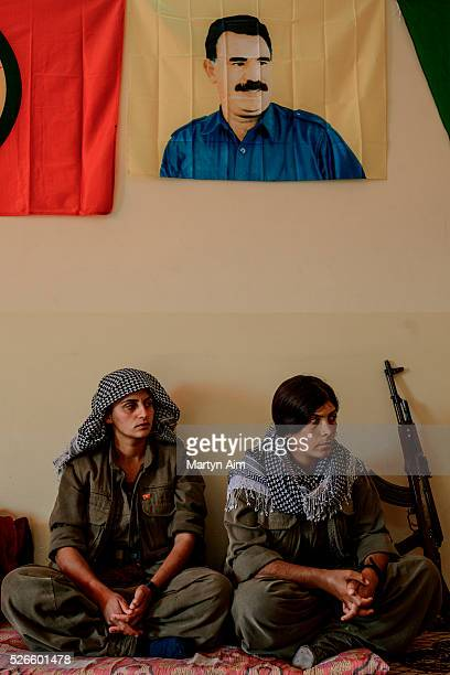 Fighters of the Kurdish YJASTAR at their base in Kirkuk province Iraq The base is on a frontline 300 metres from an Islamic State position Above them...