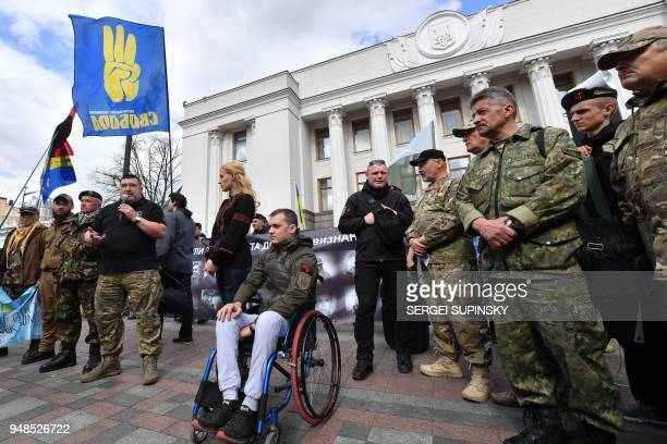 Fighters of the Ukrainian volunteer battalions warring on Donbass region with proRussian separatists rally in front of the parliament's building in...