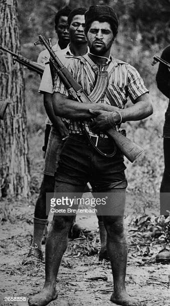 Fighters of the UNITA proWestern forces armed with a local variant of the AK47 Kalashnikov during the civil war in Angola