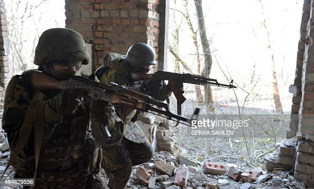 Fighters of Ukrainian volunteers battalion of Azov take part in military exercises near the southeastern Ukrainian city of Mariupol on February 27...