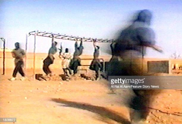 Fighters participate in military training in this undated still frame from a recruitment video for Osama bin Laden''s extremist AlQaida network