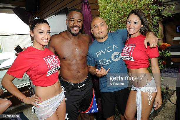 UFC fighters Rashad Evans and BJ Penn attend a pool party as part of the International Fight Week festivities at Marquee Day Club at the Cosmopolitan...