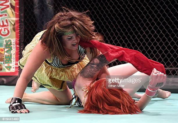 Fighters Stacey 'Full Contact' Lentz and Karly 'Zuke' Zuker compete during 'Lingerie Fighting Championships 22 Costume Brawl I' at 4 Bears Casino...