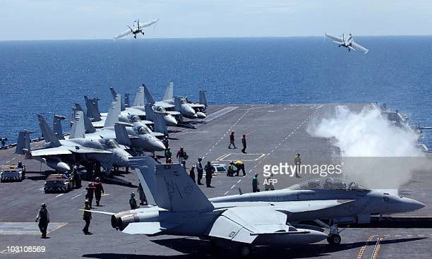 US fighters take off from the flight deck of the Nimitzclass USS George Washington for joint military exercises between the US and South Korea in...