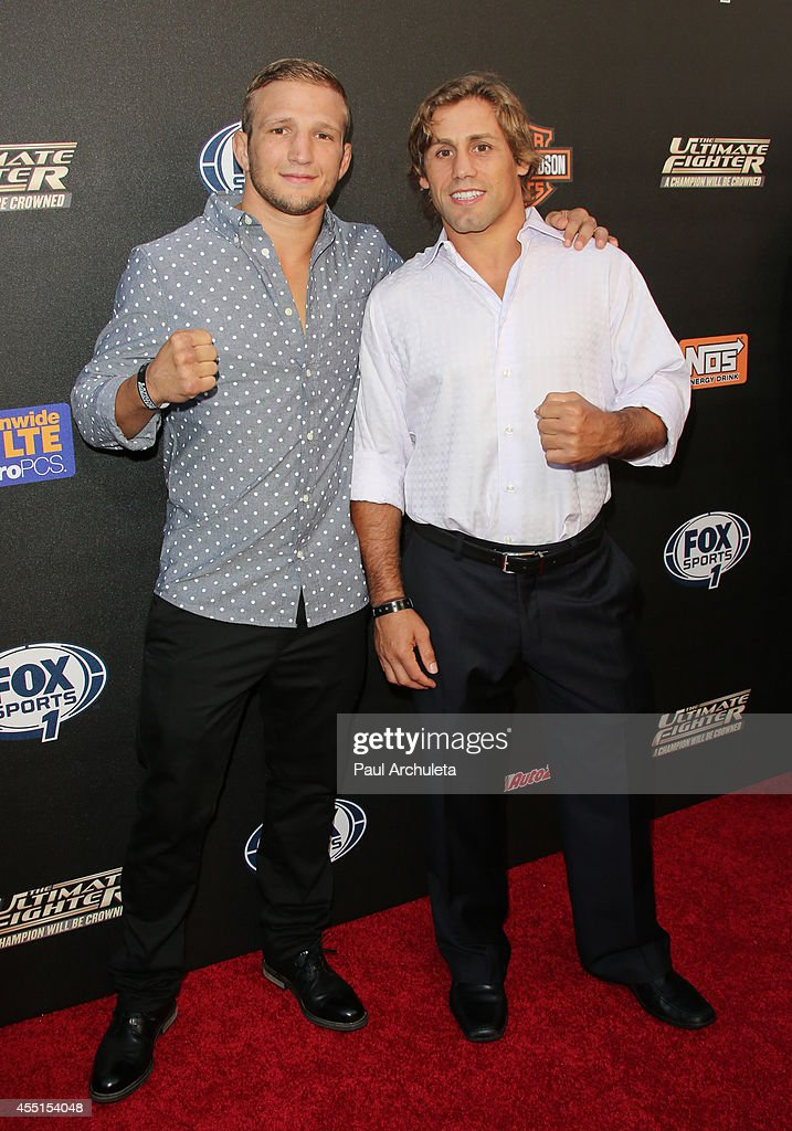 Fighters TJ Dillashaw (L) and Urijah Faber (R) attend FOX Sports 1's 'The Ultimate Fighter' season premiere party at Lure on September 9, 2014 in Hollywood, California.