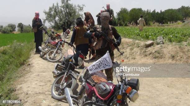 Fighters with Afghanistan's Taliban militia stand with their weapons in Ahmad Aba district on the outskirts of Gardez, the capital of Paktia...