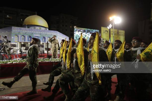 Fighters with the Lebanese Shiite Hezbollah party parade in a southern suburb of the capital Beirut to mark the alQuds International Day on May 31...