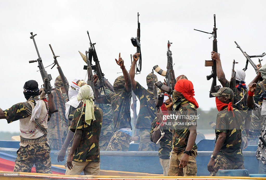 Fighters with the Movement for the Emancipation of the Niger Delta (MEND) raise their riffles to celebrate news of a successful operation by their colleagues against the Nigerian army in the Niger Delta on September 17, 2008. MEND has declared a full-scale 'oil war' against the Nigerian authorities in response to attacks by the Nigerian military launched against the militants. 'Our target is to crumble the oil installations in order to force the government to a round table to solve the problem once and for all', said Boy Loaf, leader of the militants.