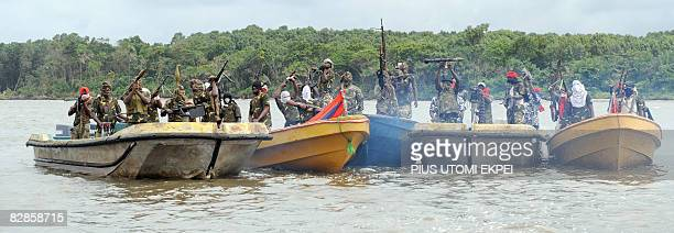 Fighters with the Movement for the Emancipation of the Niger Delta prepare to head off for an operation against the Nigerian army in the Niger Delta...