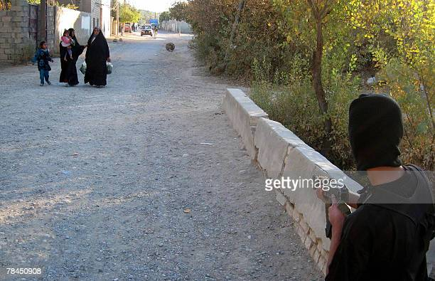 A fighters with the Sunni awakening movement patrols an area in the village of alAswad northeast of Baghdad 13 December 2007 There are around 80000...