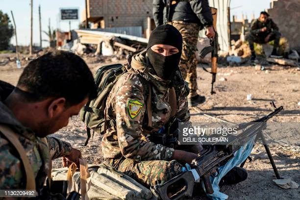 Fighters with the Syrian Democratic Forces are pictured in the town of Baghouz on the frontline of fighting to expel the Islamic State group from the...