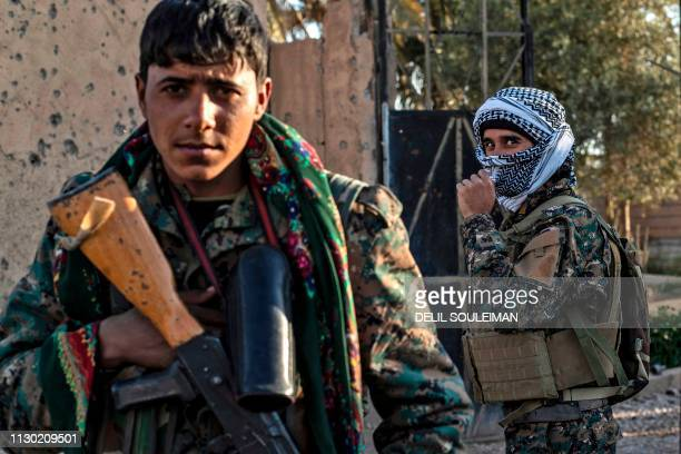 Fighters with the Syrian Democratic Forces are pictured in the town of Baghouz, on the frontline of fighting to expel the Islamic State group from...