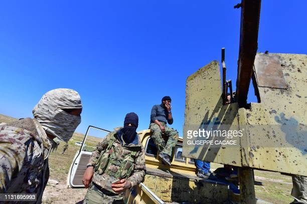 Fighters with the Syrian Democratic Forces gather near the village of Baghouz in the countryside of the eastern Syrian province of Deir Ezzor on...