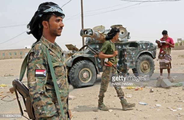 Fighters with the UAEtrained Security Belt Forces loyal to the proindependence Southern Transitional Council gather near the southcentral coastal...