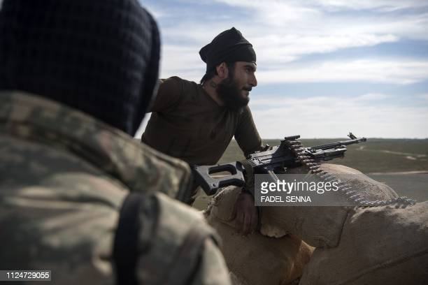 Fighters with the USbacked Syrian Democratic Forces keep position during an operation to expel Islamic State group jihadists from the Baghouz area in...