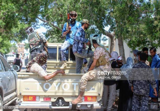 Fighters with Yemen's separatist Southern Transitional Council deploy in the southern city of Aden, on April 26 after the council declared self-rule...