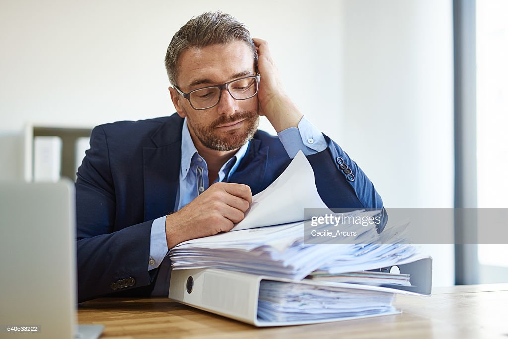 Fighting a losing battle against paperwork : ストックフォト