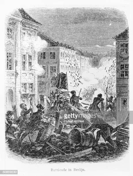 Fighting at a barricade in a Berlin street during the revolution of 1848