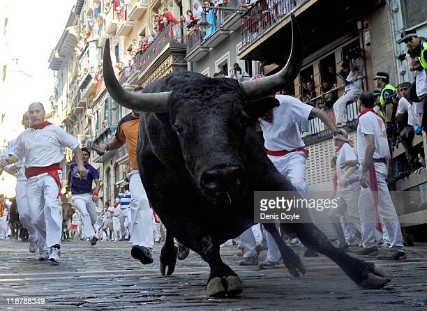A fighting bull goes around Estafeta corner on the sixth day of the San Fermin runningofthebulls on July 11 2011 in Pamplona Spain Pamplona's famous...
