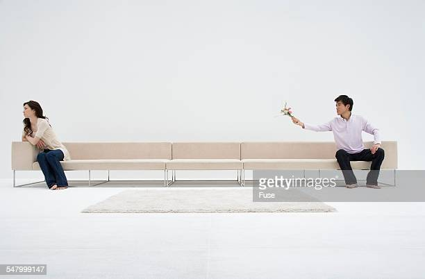 Fighting Couple on Long Sofa
