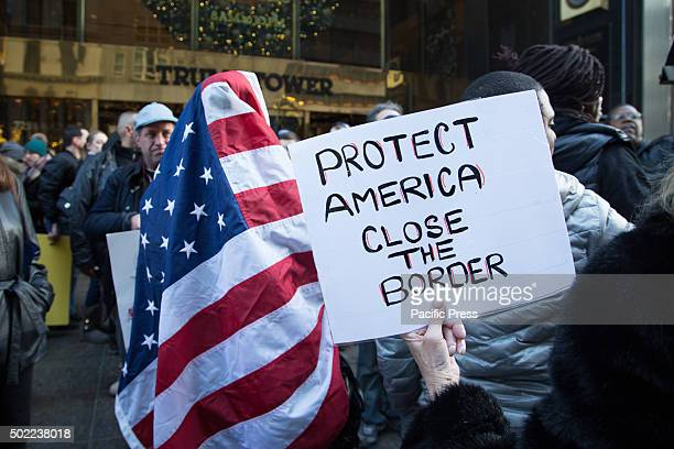 Fighting erupts between pro and anti Trump supporters outside the Trump Towers on 5th Avenue New York Police intervene to separate those protesting...
