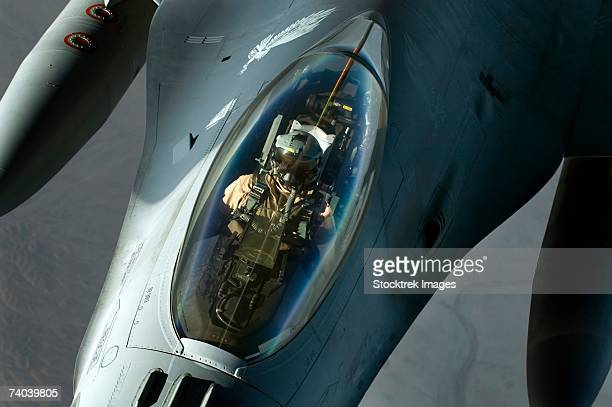 A F-16 Fighting Falcon detaches from a KC-135 Stratotanker after refueling over Iraq in support of Operation Iraqi Freedom.