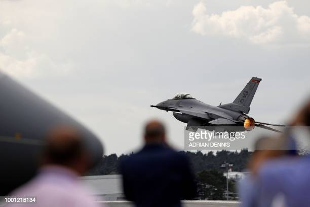 Fighting Falcon fighter jet takes takes part in a flying display at the Farnborough Airshow south west of London on July 18 2018