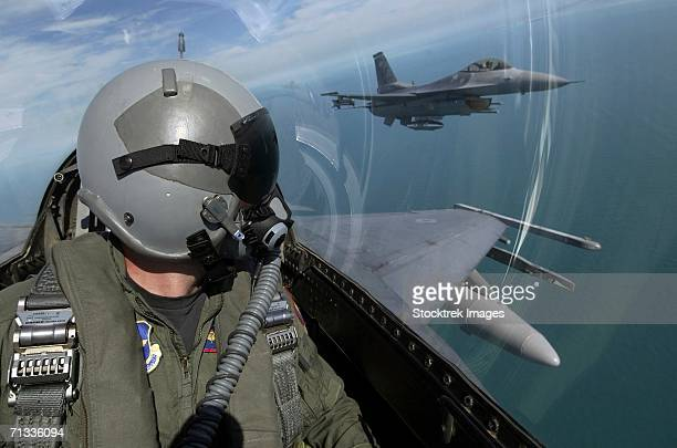 f-16 fighting falcons from the 62nd fighter squadron, luke air force base, ariz., fly over southern florida during a flight from luke to key west, fla., oct. 16, 2004. - air force stock pictures, royalty-free photos & images